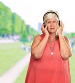 Portrait Of A Senior Woman Listening Music — Foto de Stock