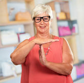 Portrait Of A Senior Woman Showing Time Out Signal — Stock Photo