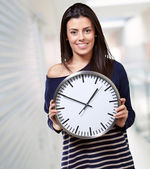 Young Girl Showing Clock — Stock Photo
