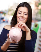 Portrait Of A Young Girl Holding A Piggy Bank — Stock Photo