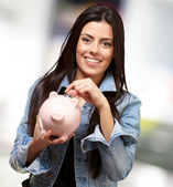 Portrait Of A Female Holding A Coin And Piggybank — Stock Photo