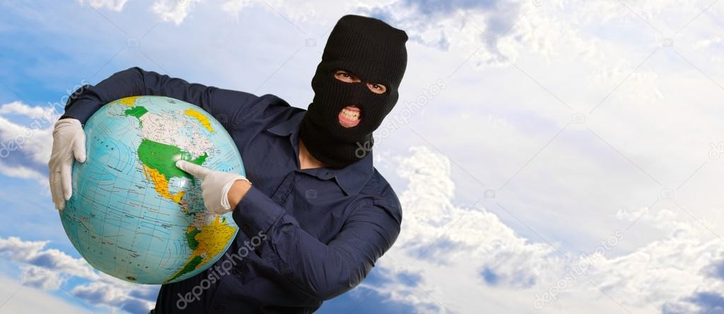 Burglar Man Holding Globe, Outdoor  Stock Photo #12666453