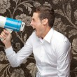 Portrait Of Young Man Shouting On Megaphone — Stock Photo