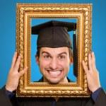 Graduate man looking through a frame — Stock Photo #13305260