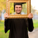 Graduate man looking through a frame — Stock Photo #13305272