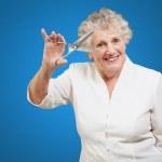 Senior woman holding scissors — Stock Photo