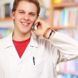 Portrait of a doctor using cellphone — Stock Photo