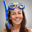 Portrait of a happy middle aged woman wearing snorkel and goggle - Stock Photo