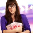 Girl Holding Empty Popcorn Packet — Stock Photo