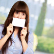 Woman Holding Blank Card — Stock Photo #13309615
