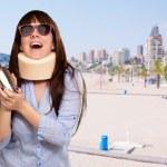 Woman Wearing Neckbrace Holding A Shaker — Stock Photo