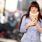 Woman Wearing Neckbrace — Stock Photo #13309736