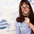 Woman Holding Magnifying Glass On Mouth — Stock Photo #13309742
