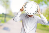 Young Man Holding Big Clock Covering His Face — Stock Photo