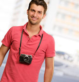 Portrait of a man wearing camera — Stock Photo