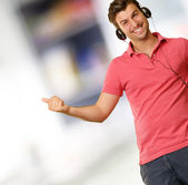 Young man wearing headphones — Stock Photo