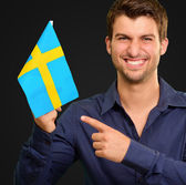 Portrait of a man holding flag — Stock Photo