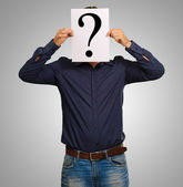 Man standing with a question mark board — Stock Photo