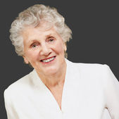 Portrait of a senior woman smiling — Stock Photo