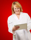 Female doctor holding digital tablet — Stock Photo