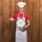Portrait Of A Young Man Holding A Clock — Stockfoto