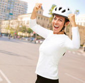 Woman wearing helmet cheering — Stock Photo