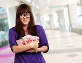 Woman Holding Empty Popcorn Packet — Stock Photo