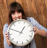 A Young Girl Holding A Clock And Angry — Foto de Stock