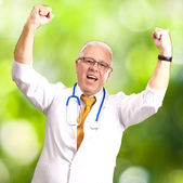 Senior Male Doctor In A Winning Gesture — Stock Photo