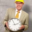 Portrait Of A Senior Man Holding A Wall Watch — Stock Photo #13310227
