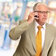 Senior Man Talking On Phone — Stock Photo #13310308