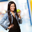 Woman Holding Green Apple - Stock Photo