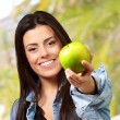 Woman Showing Green Apple - Stock Photo
