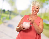 Senior Woman Holding A Piggybank — Stock Photo