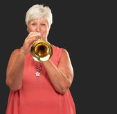 Mature Woman Blowing Her Trumpet — Stock Photo