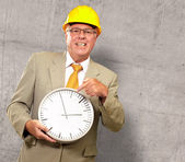Portrait Of A Senior Man Holding A Wall Watch — Foto de Stock