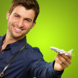 Stock Photo: Man Holding A Miniature Airplane