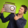 Young Man Listening To Vintage Radio — Stock Photo #13360826