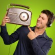 Young Man Listening To Vintage Radio — Stockfoto #13360826