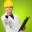 Architect Holding Clipboard And Pointing — Stock Photo #13361389