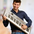 Young Man Holding Piano — Stock Photo