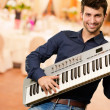 Young Man Holding Piano — Stock Photo #13362319