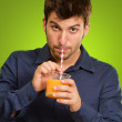 Young Man Drinking Juice — Stock Photo #13362406
