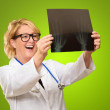 Female Doctor Examining X-ray Report — Stock Photo