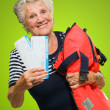 Portrait Of Senior Woman Holding Boarding Pass And Luggage — Stock Photo