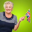 Happy Senior Woman Waving United Kingdom Flag — Stock Photo #13362726