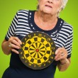 Stock Photo: Sad Mature Woman Holding Dartboard