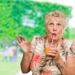 Senior Woman Drinking Orange Juice — Stock Photo