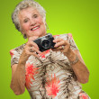 Senior Woman With Old Camera — Stock Photo
