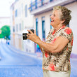 Happy Senior Woman Holding Camera — Foto de Stock
